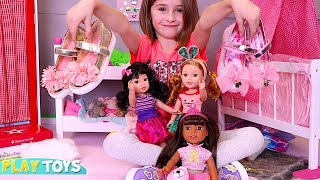 Cute Little Girl Playing American Girl Dolls Wellie Wishers Kids Magical Shoes by Play Toys!s