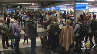 American Airlines Customers Struggle To Find Bags After Weather Delays
