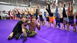 Who can HOLD the LONGEST HANDSTAND wins $10,000!