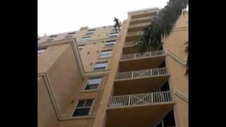 Australian abseiling down hotel