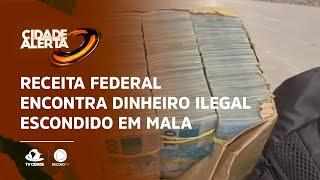 Receita federal encontra dinheiro ilegal escondido em mala