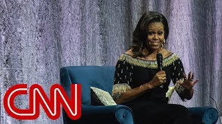 Michelle Obama compares Trump to a 'divorced dad'