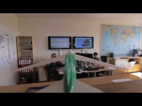 Plane flying around Grossmann Jet's office