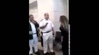 سيدة تعتدى على ضابط شرطه فى مطار القاهرة (ياسمين النرش)