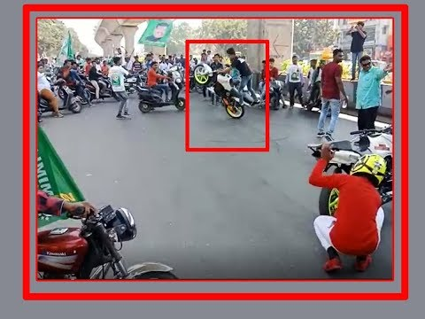 MIM activists make bike stunts at middle of the road in Hyd