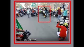 MIM activists make bike stunts at middle of the road in Hy..