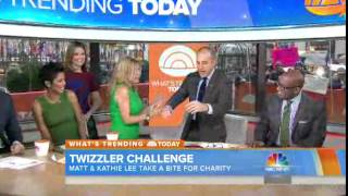 Kathie Lee Gifford and Matt Lauer share an awkward kiss for the Twizzler Challenge
