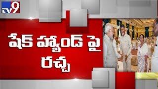 AP shakes over Chandrababu-Modi handshake..