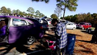 My wife demoing my car at ruckus and chill show BOOM BABY