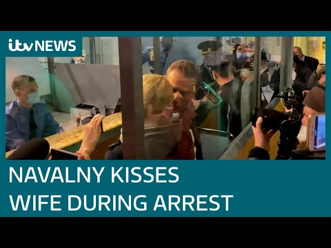 Poisoned Kremlin critic Alexei Navalny kisses wife goodbye as he is arrested | ITV News