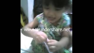 A 3year old girl shailem playing with her sweet's & choclate2