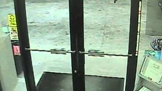 Man kicks through glass door