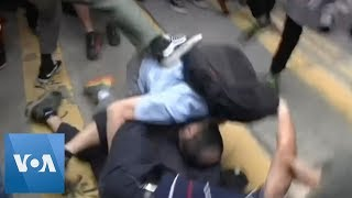 Hong Kong Protesters Attack Man Who Appeared to Confront Them