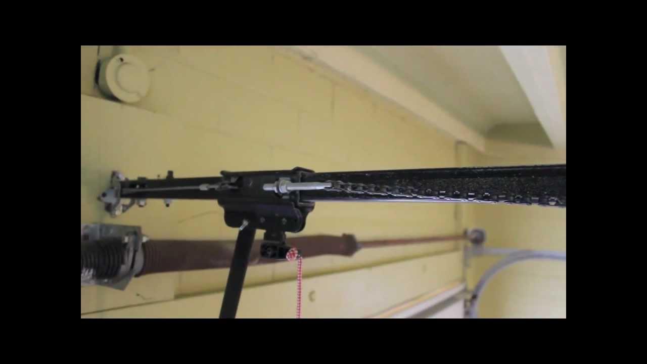 How To Repair Garage Door Opener Loose Chain Fix Gear