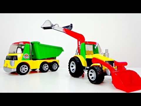 A Bruder tractor, a toy truck & PAW Patrol toys.