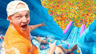 BIGGEST Backyard Water Slide With 100 MILLION ORBEEZ!