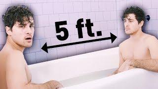 2 bros chillin in a bath tub