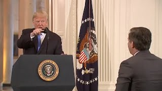 Trump calls CNN reporter 'rude, terrible person,' 'enemy of the people'